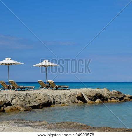 Crystalline Mediterranean Sea On A White Sand Beach