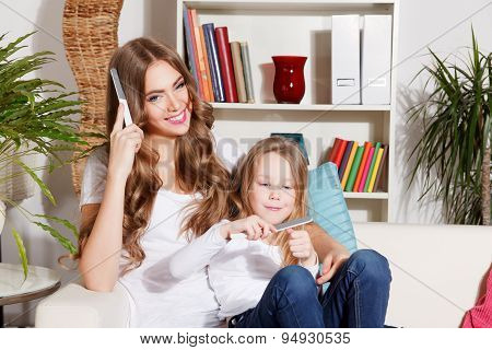 Happy Mother And Daughter Doing Manicure