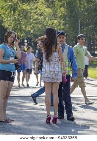 Donetsk, Ukraine - June 11, 2012: Young Officer Was Talking To A Woman