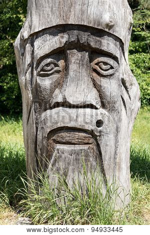 Face carved in wood