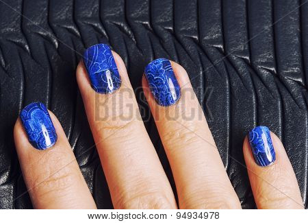 pretty fingers, deep blue manicure close up with purse, luxury d