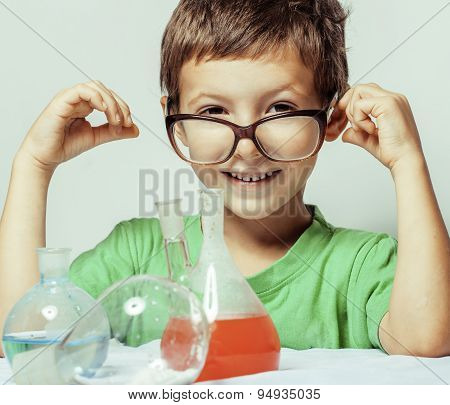 little cute boy with medicine glass isolated wearing glasses smi