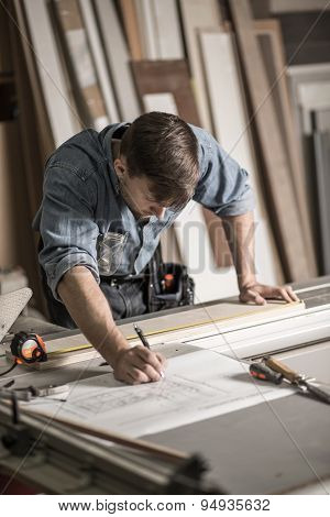 Focused Joiner Working In Carpentry