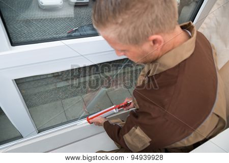 Person Applying Silicone Sealant