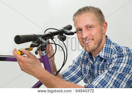 Man Repairing Bicycle Handlebar
