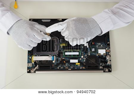 Technician Repairing Laptop