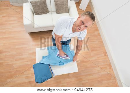 Happy Man Ironing Clothes