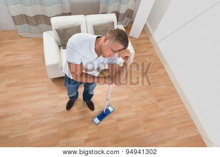 Man With Mop At Home