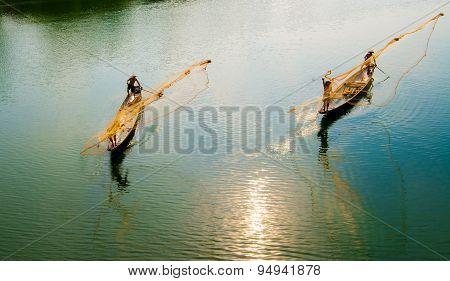 Fishermen are throwing fishing net in Hue, Vietnam