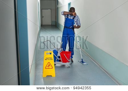 Tired Male Janitor