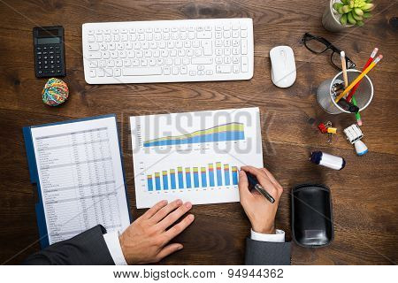 Businessman Analyzing Graph