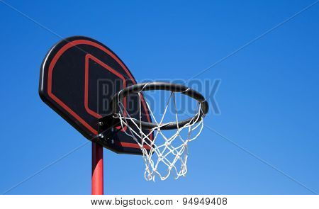 Basketball hoop on a blue sky background