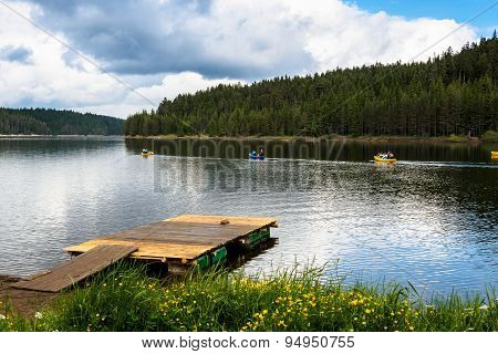 Canoes In A Mountain Lake.