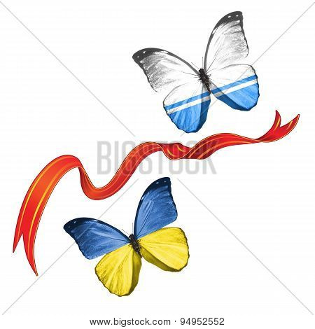 Two butterflies fluttering with flags of Ukraine and the Altai (Russia), between the red ribbon