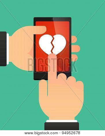 Man's Hands Using A Phone Showing A Broken Heart