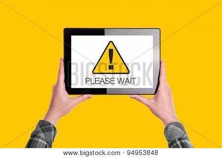 Please Wait Message On Digital Tablet Computer Display