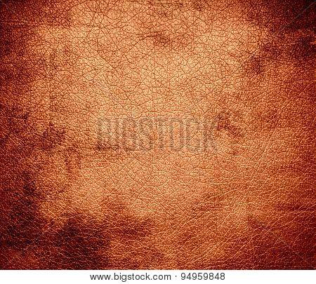 Grunge background of atomic tangerine leather texture