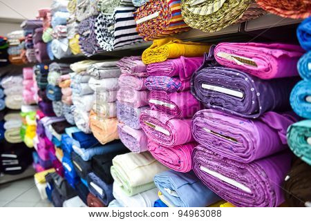 Rolls Of Fabri And Textiles In A Factpory Shop.
