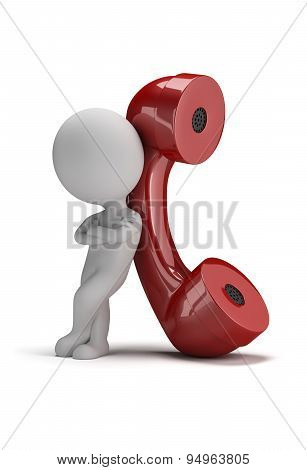 3d small person standing next to a large handset. 3d image. Isolated white background.