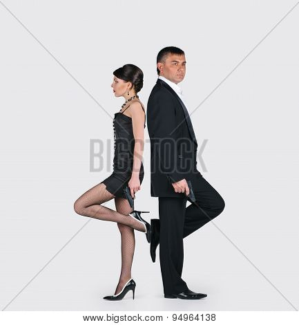 Young couple with guns