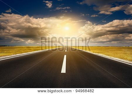 Driving On An Open Asphalt Road At Sunset