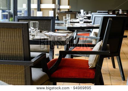 Interior Of Resturant With Black Wooden Table And Chair
