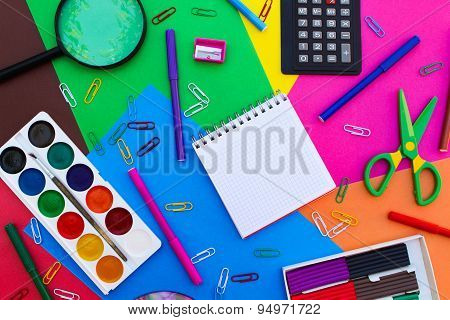 Stationery objects. Office and school supplies on the background of colored paper. back to school.
