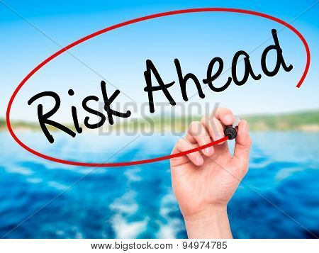 Man Hand writing Risk Ahead with black marker on visual screen.