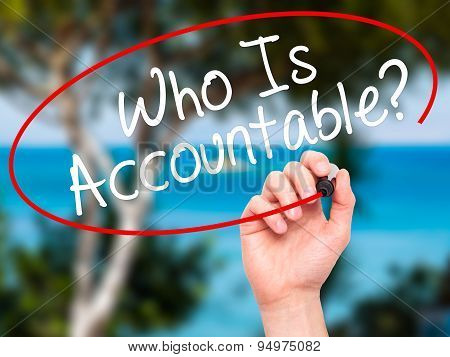 Man Hand writing Who Is Accountable? with black marker on visual screen.