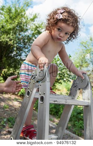 Baby Girl Climbing On Step-ladder