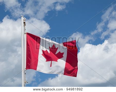 Sun, Clouds And Canadian Flag
