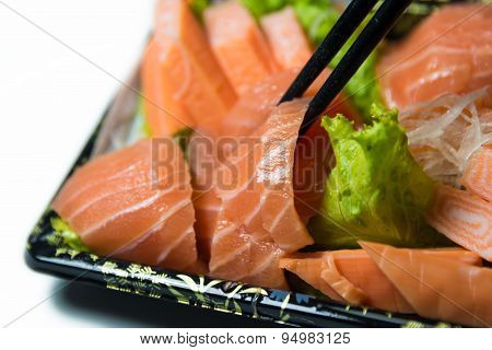 Chopstick Grab A Slice Of Salmon Sashimi Japanese Food   Closeup Isolated