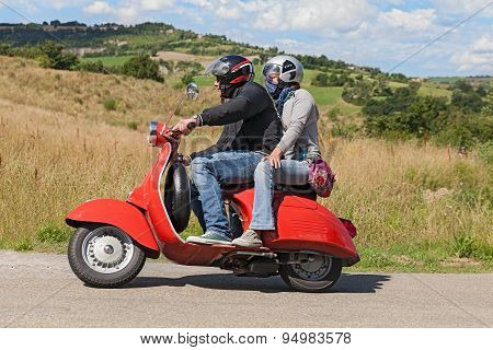 Couple Riding Vintage Scooter Vespa
