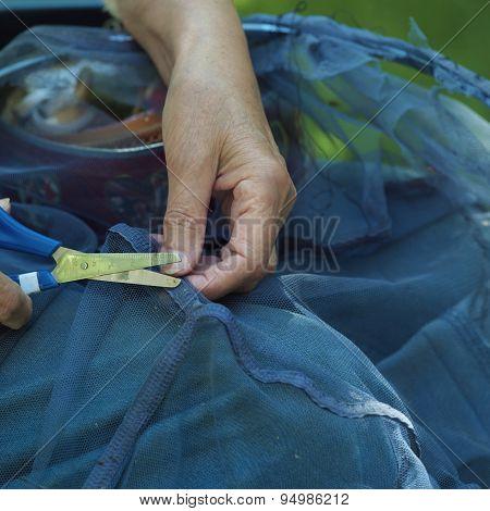 Scissors In Female Hands