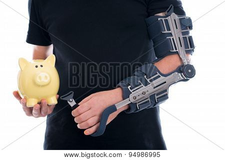 Man With Broken Arm Showing Piggy Bank