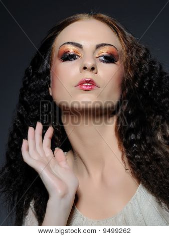 Beauty Portrait Of Woman Face With Creative Fashion Make-up In Amber Tones, Even Fondation And Perma