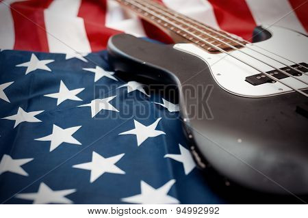Vintage bass guitar on an american flag background