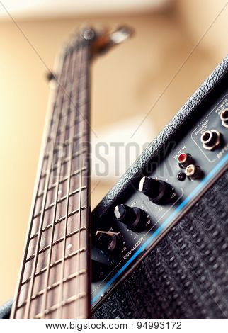 Five string bass guitar and amplifier. Selective focus image