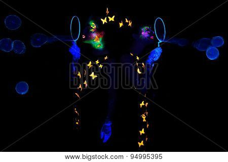 Image women blowing bubbles, luminous make up