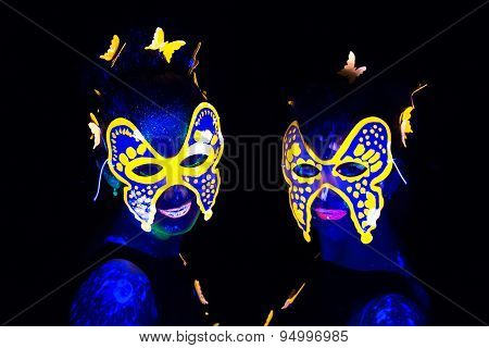 Photo of two women in luminous masks