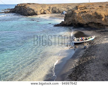 Boat And Tent On Beach