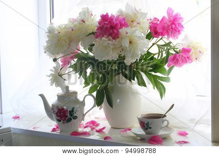 Still-life With Tea And A Bouquet Of Peonies On A White Window Sill
