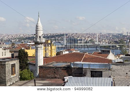 Minaret Samani Virani and the Golden Horn metro bridge. Istanbul