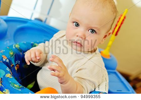 Baby Playing In Baby Jumper