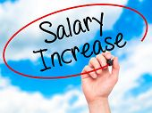 pic of employee month  - Man Hand writing Salary Increase with black marker on visual screen - JPG