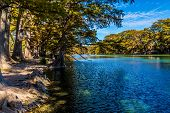pic of crystal clear  - Bright Beautiful Fall Foliage On The Crystal Clear Frio River at Garner State Park - JPG