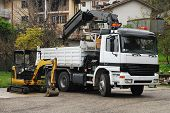 pic of hydraulics  - A compact mini hydraulic excavator with a rotating house platform and a truck - JPG