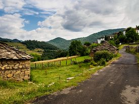picture of old stone fence  - Road in a old mountain village in Bulgaria - JPG