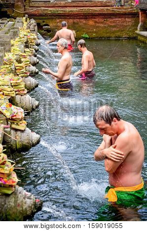Bali Indonesia - August 11: tourist was washed his body at the Bali Holy Spring Water Temple. on August 112011 at Bali Holy Spring Water Temple Indonesia.