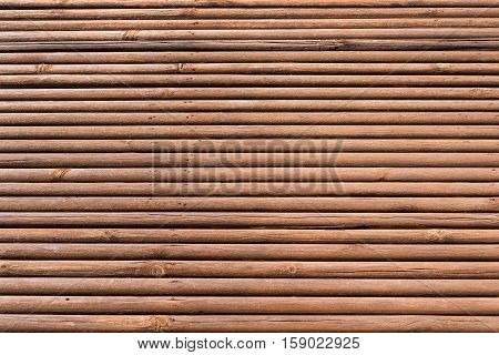 old wooden shafts or corrugated texture of uneven background of brown color